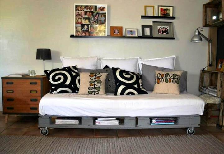 grey painted pallet sofa on wheels with storage