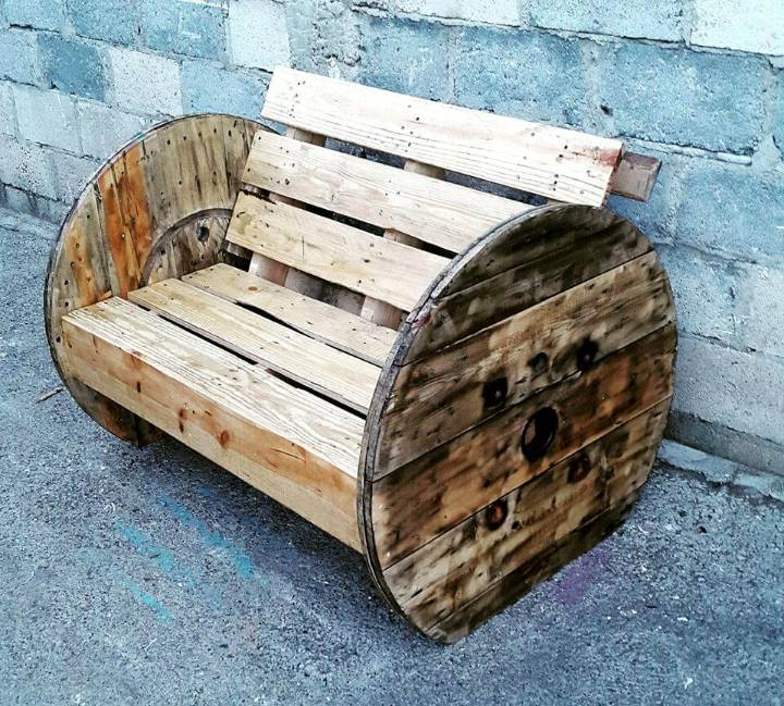 handmade wooden pallet and spool wheel bench