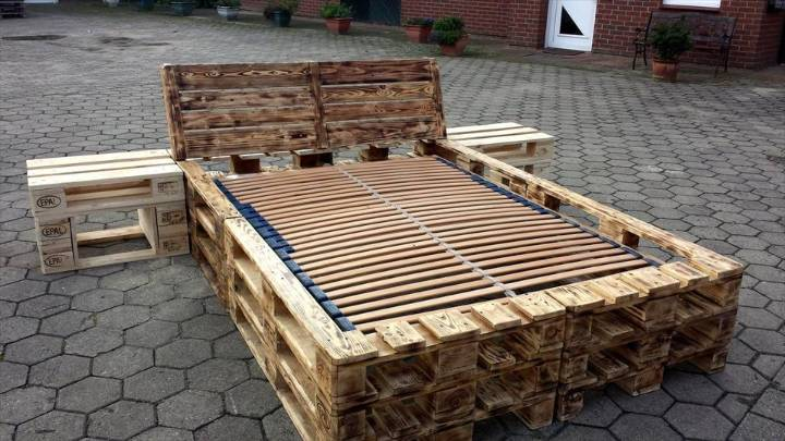 robust wooden pallet bed frame with nightstands and headboard
