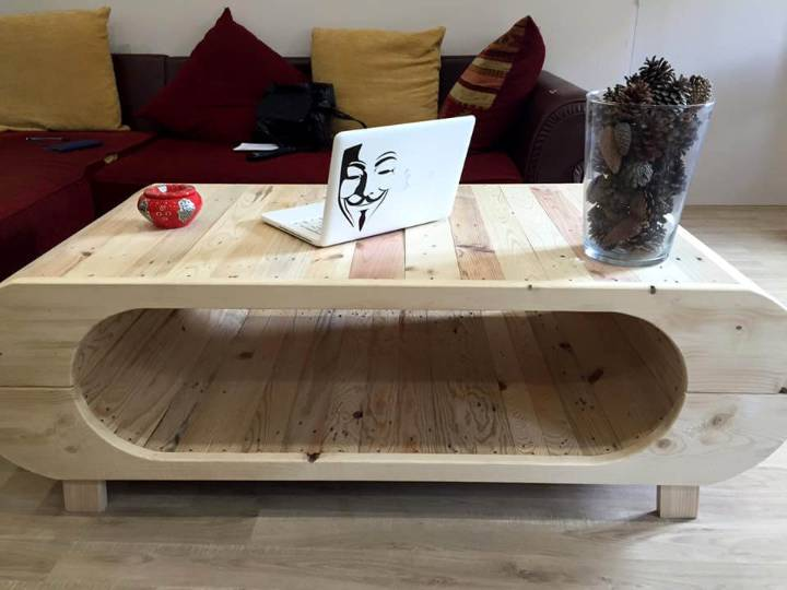 art style pallet coffee table with stadium-shaped inside cubby