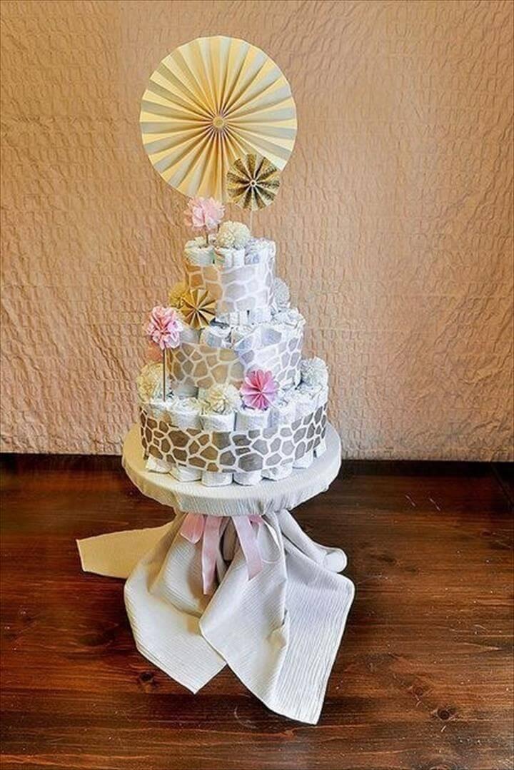 giraffe printed ribbon wrapped diaper cake