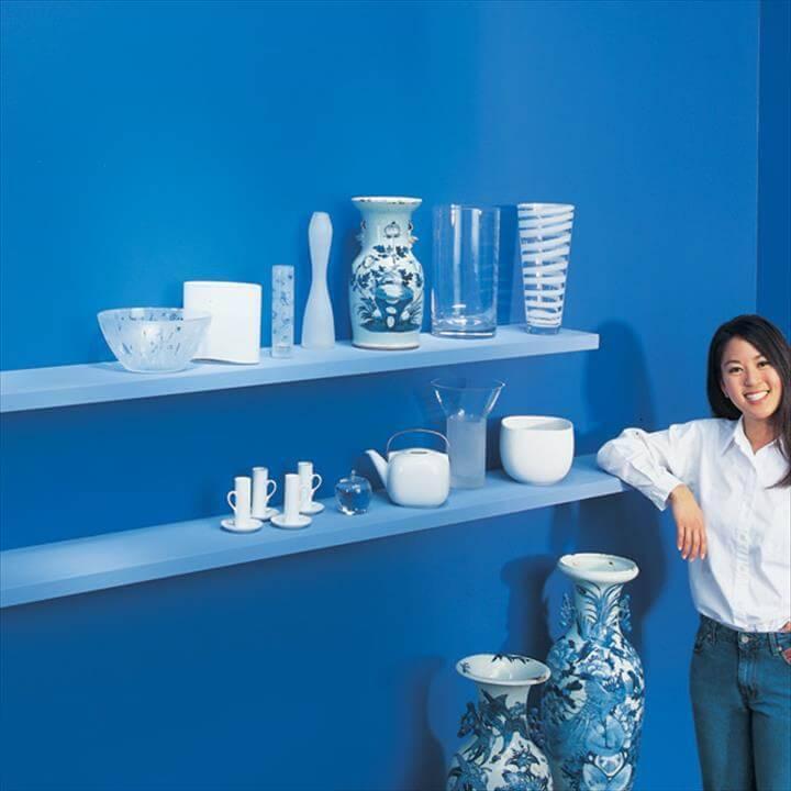 homemade blue painted wooden floating shelves