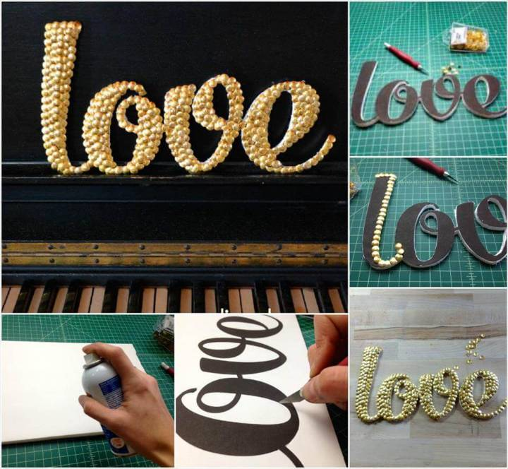 self-made LOVE letter art with thumb tacks