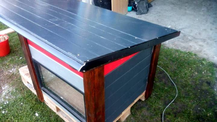 repurposed pallet and recycled door panels dog house