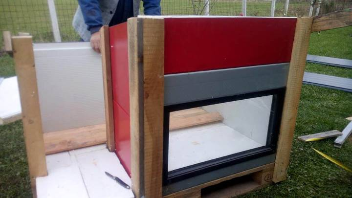 upcycled pallet wood and recycled old door panels modern dog house