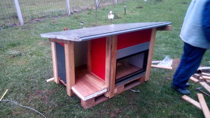 modern dog house made of pallets and old door panels