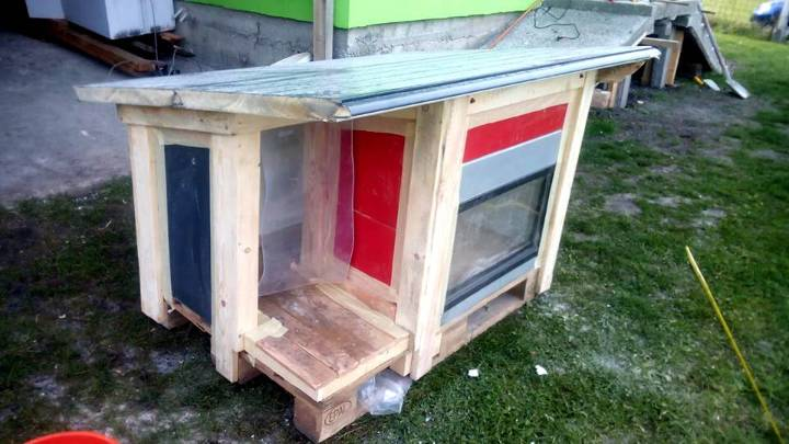 pallet and reclaimed door panels dog house