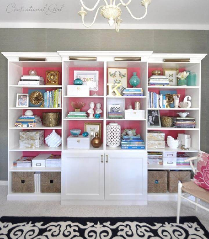 DIY IKEA BILLY BESTA Bookshelf Wall With Pink Backing And Brass Lighting