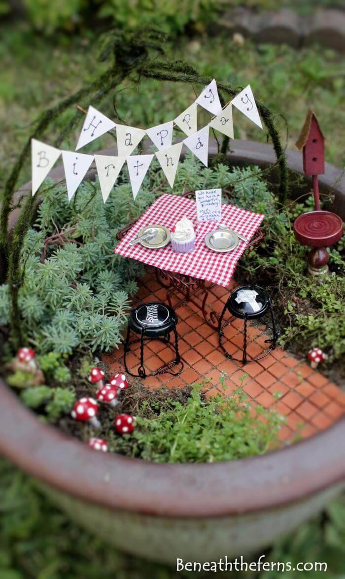 A picnic themed fairy garden