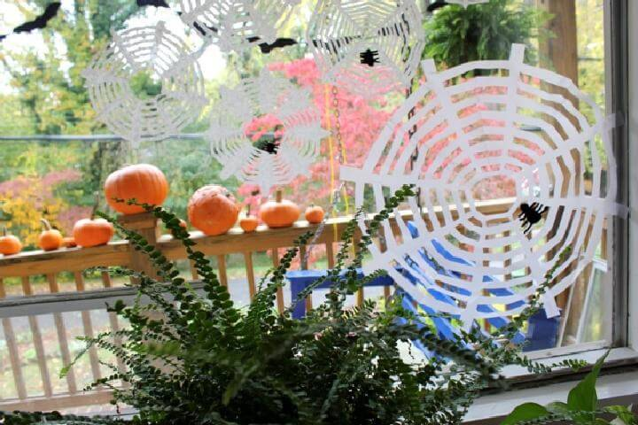 DIY Coffee Filter Spider Webs for Halloween
