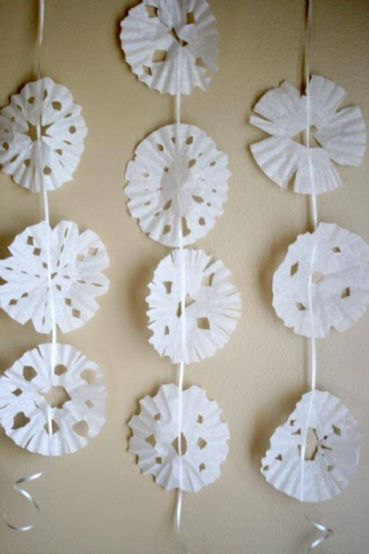 DIY Super Easy Coffee Filter Snowflakes on a String