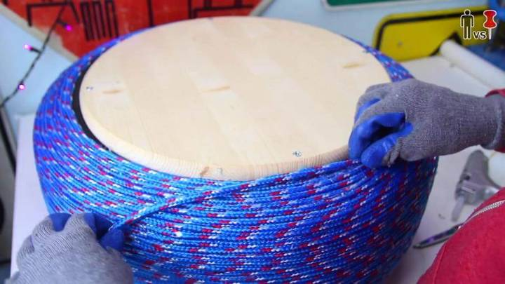 adding glue and coiling the wood around the center in spiral manner step 7