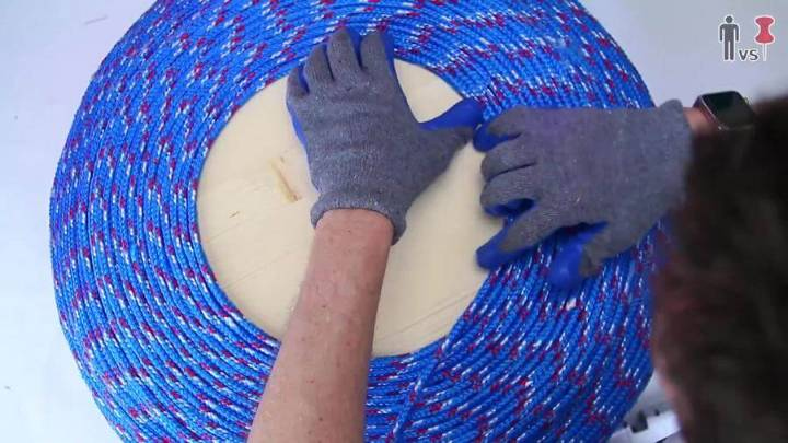 adding glue and coiling the wood around the center in spiral manner step 8