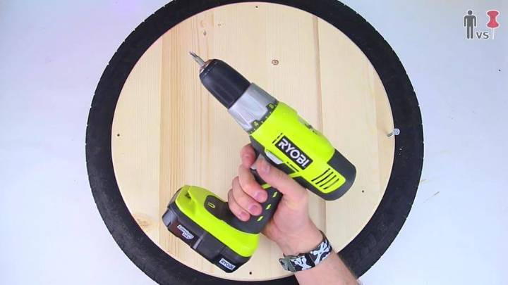 Drilling holes in the wood to tire