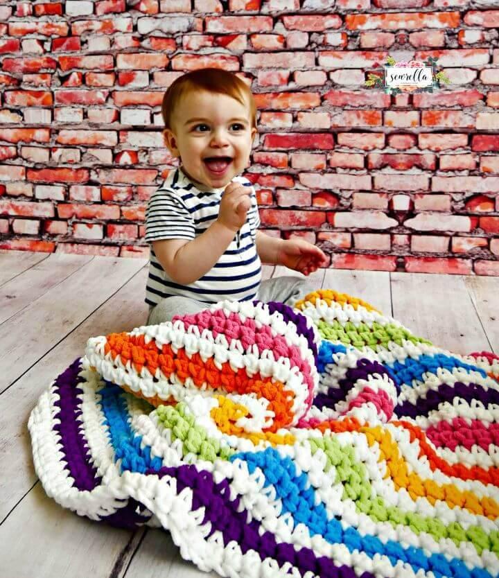 Häkeln Sie Rainbow Stripes Babydecke - kostenlose Muster