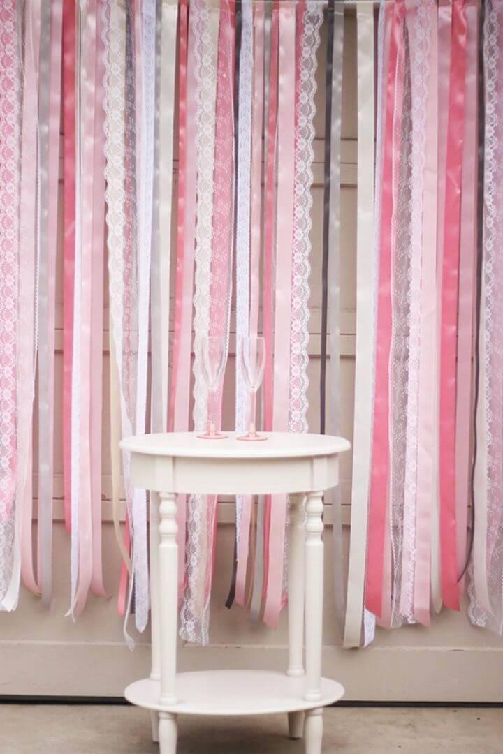 Adorable DIY Ribbon + Lace Backdrop