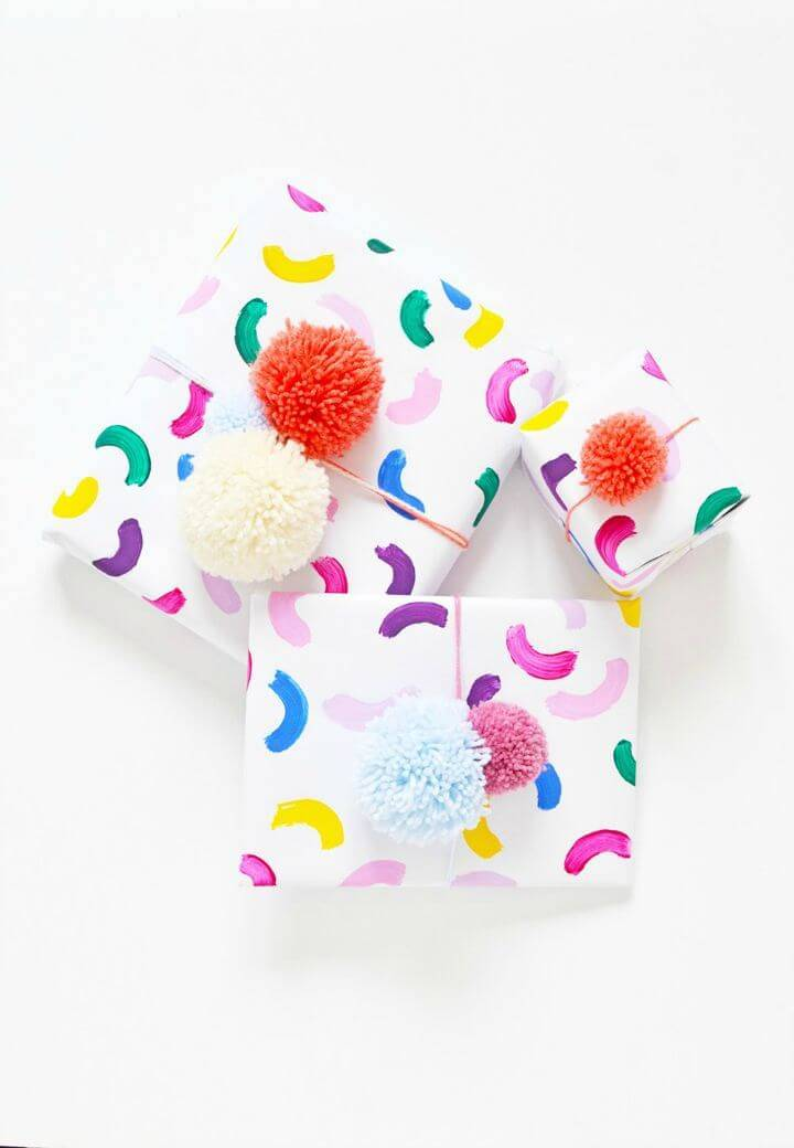 Colorful DIY Gift Wrap with Pom Pom Toppers