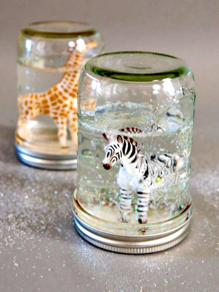 Pretty DIY Glitter Snow Globes from Mason Jars