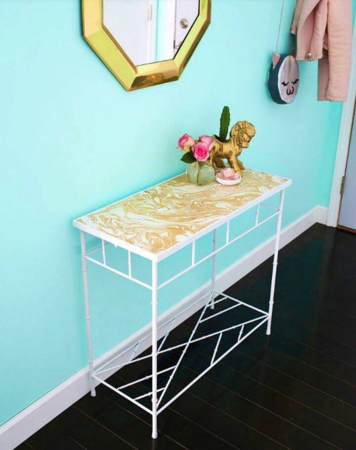 Adorable DIY Gold-marbled Entryway Table, renovate also your accent entryway table using a gold marble contact paper!