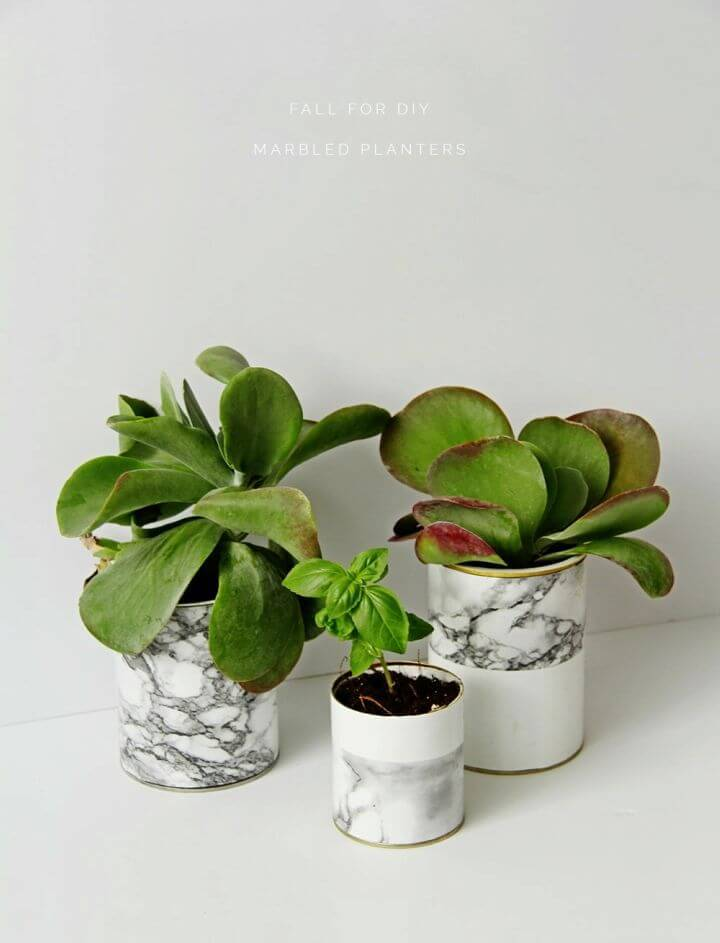Awesome DIY Marble Planters, a create a pretty faux marble appeal of the patio or indoor pots or vases using marble contact paper!