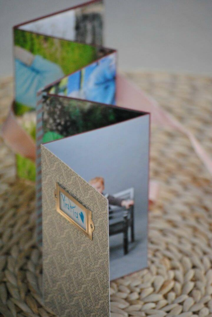 DIY Homemade Photo Album, photo albums may be expensive to by so you can consider making your photo albums like a pro at home just like this given one!