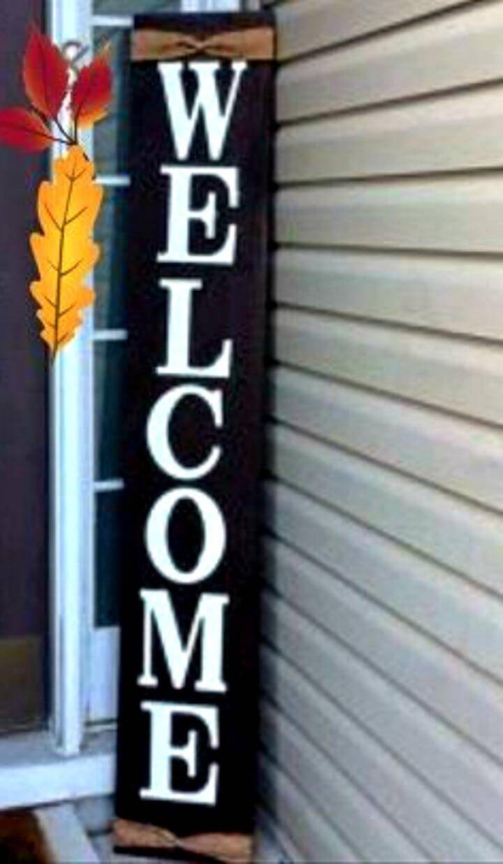 DIY Oversized Welcome Front Door Sign, bring decorative vibes to your porch with this black and white wood plank welcome sign!