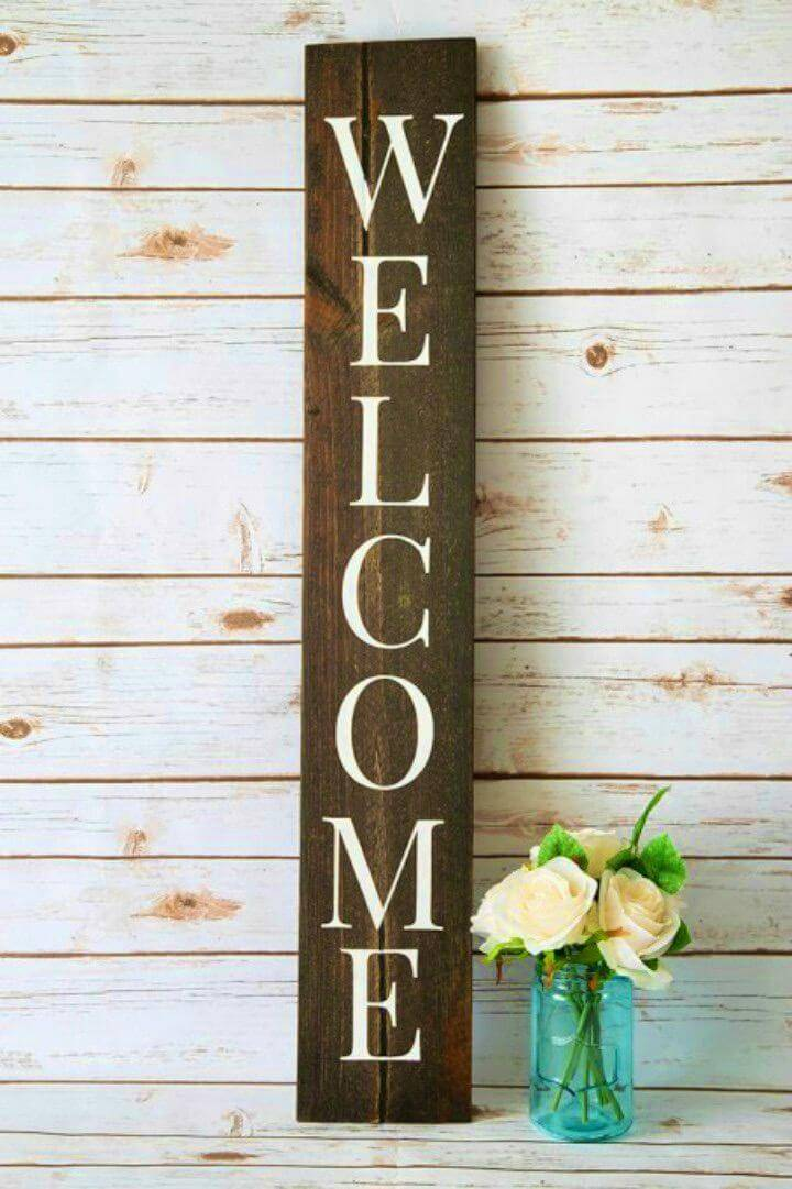 DIY Welcome Sign with a Silhouette, transfer the silhouette vinyl letters on a wooden board and make a porch welcome sign!