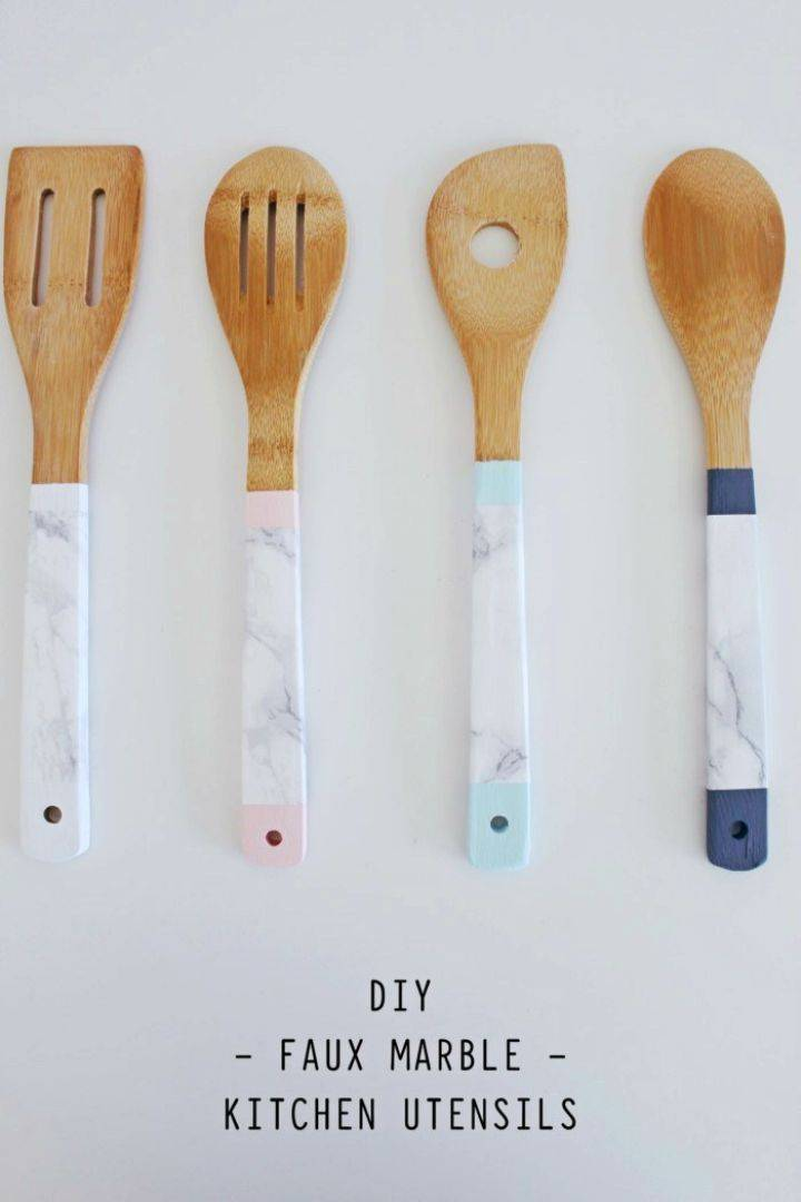 How to Make Faux Marble Kitchen Utensils, wrap also the marble contact paper all around the handles of wooden kitchen utensils and create a marble look of them!