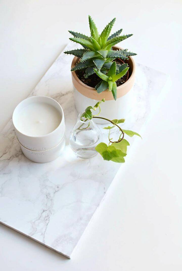 How to Make Marble Coffee Table Tray, also treat the coffee table trays with the marble contact paper to create a gorgeous marble appeal of them!