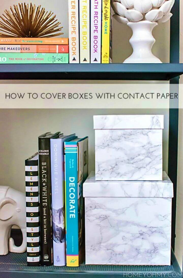 Make Cover Boxes with Contact Paper, grab also the marble contact paper and wrap it around your gift boxes and get them instantly marbleized!