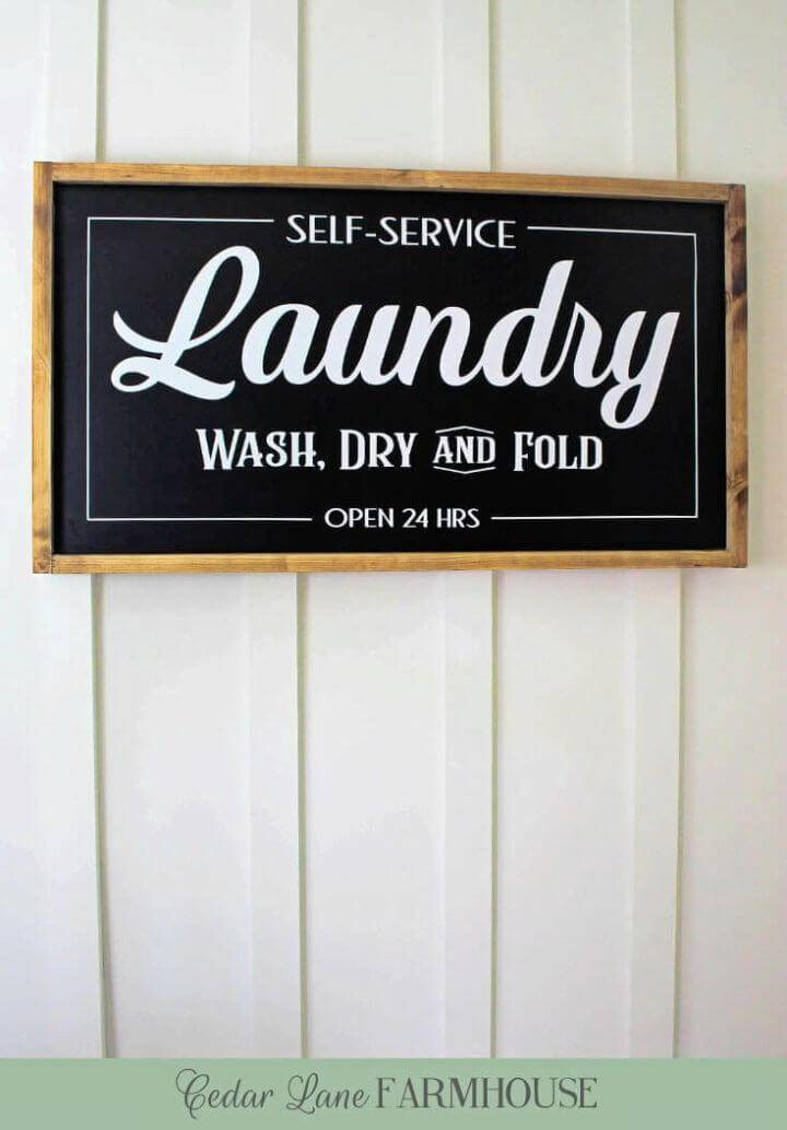 Make Farmhouse Laundry Sign, highlight your laundry with this wooden laundry sign that you can easily make with recycled wood and paint!