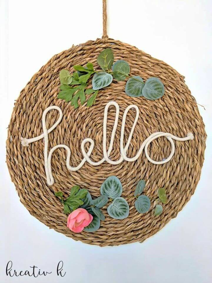 Make Hello Sign Using a Yute Place Mat, go handmade and make interesting hello signs out of it using additional white rope and accent faux flowers!