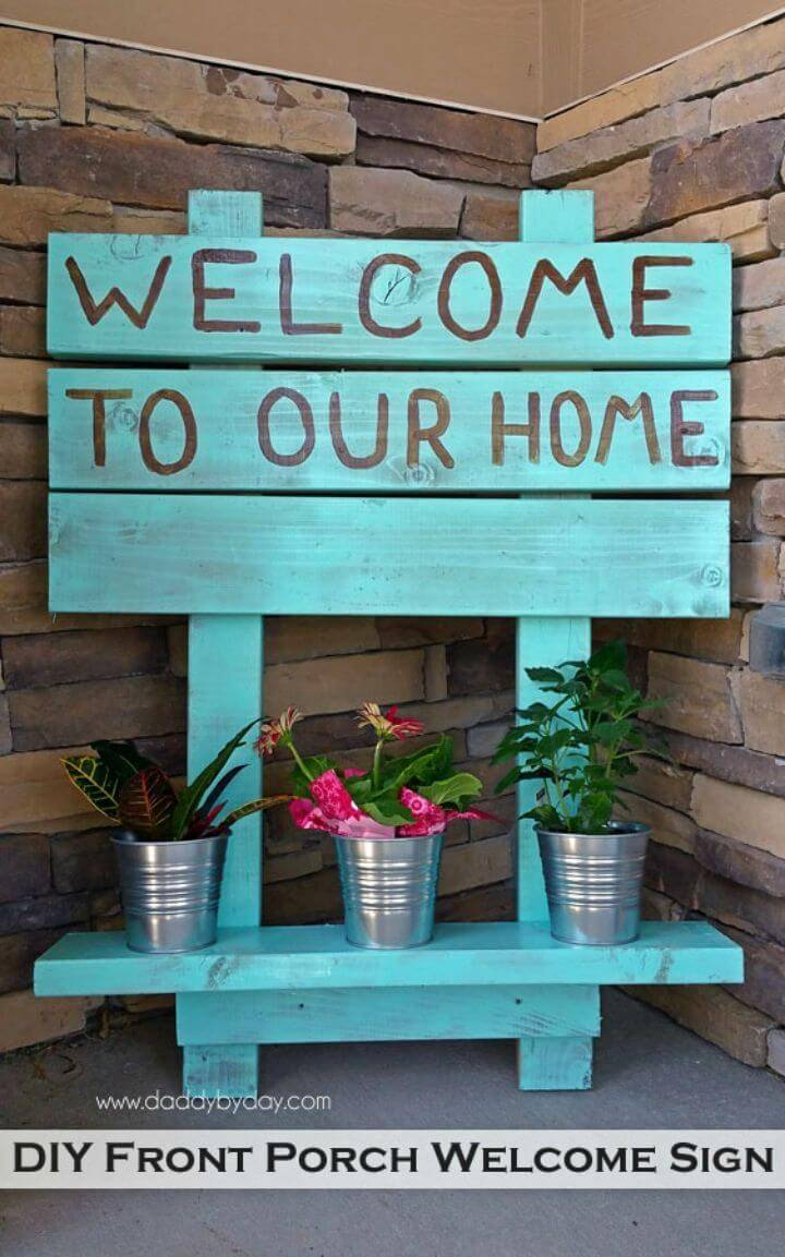 Pretty DIY Front Porch Welcome Sign, decorate your front porch by hanging custom painted and quoted signs that you can quickly make using recycled wood boards!