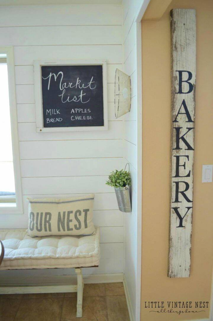Simple DIY Bakery Sign, by simply writing custom letters on the wood planks, make this adorable bakery letter for your kitchen!