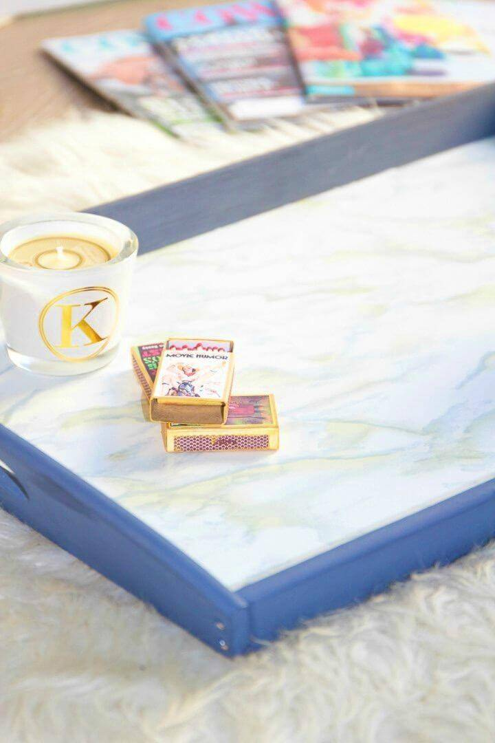 Simple DIY Faux Marble Ikea Tray, use the marble contact paper to create a faux marble appeal of anything thing like this tray!