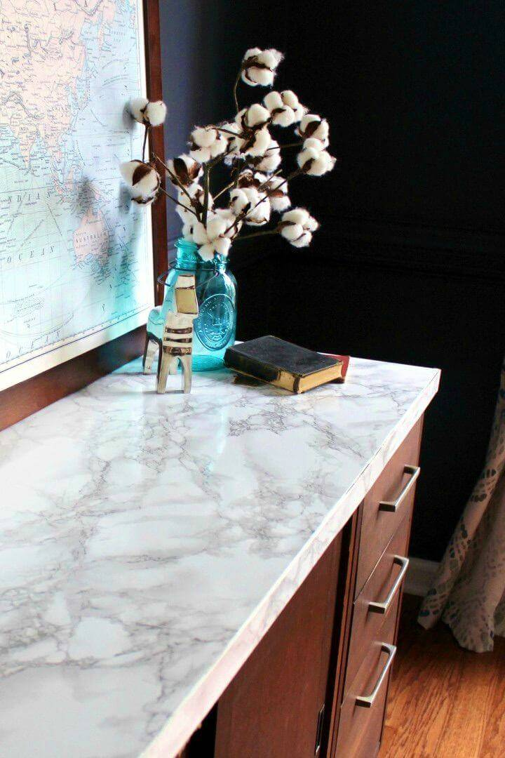 Simple DIY Faux Marble Tabletop, it is expensive to buy marble counter tops, so save a lot of your money for the marbled furniture by making faux marble furniture using marble contact paper!