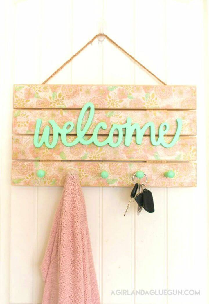 Simple DIY Floral Welcome Sign, Boost both the functional behavior and decor of your porch with this floral welcome sign that comes with hooks too!
