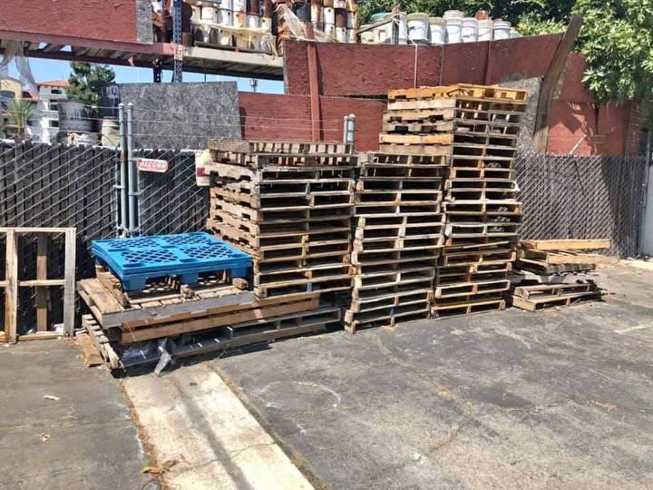 Find free pallets outside of businesses. but ask first