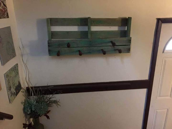 pallet coat rack with railroad spikes hooks