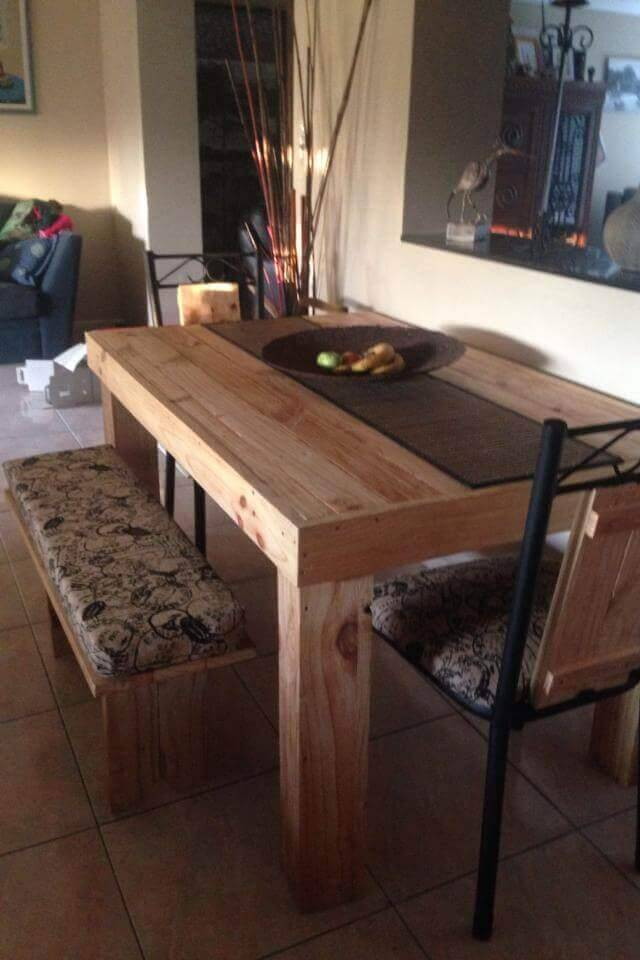 wooden pallet rustic dining table with cushioned benches and chair