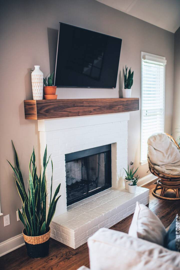 Brick Fireplaces with White Mantels
