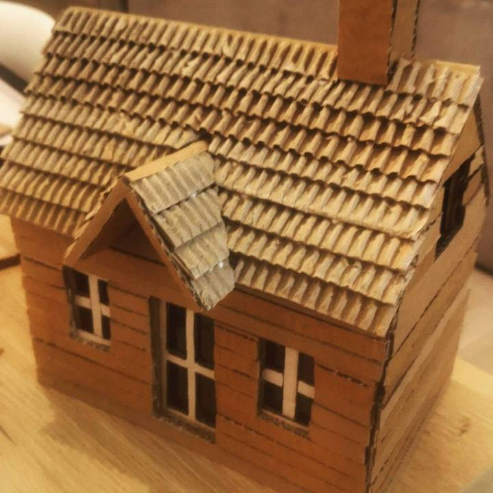 recycle old cardboard to make a simple house